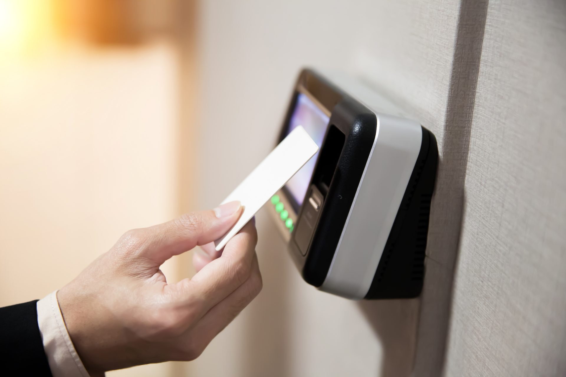 close-up-of-hand-using-keycard-to-open-the-door