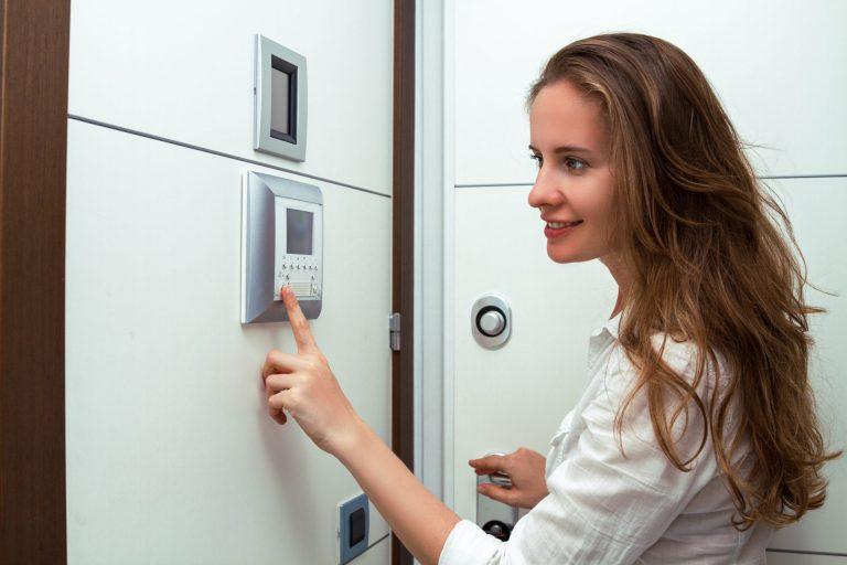 the-beautiful-girl-the-opening-door-of-the-apartment-using-video-door-phone-of-intercom-system